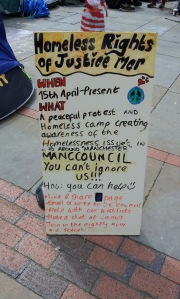 Placard at protest camp in St Ann's Square.