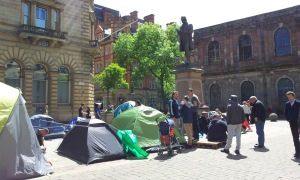 Protest camp with St Ann's Church in background.