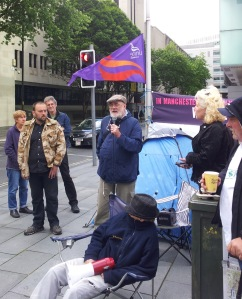 John Clegg (Unite Community Branch Grt. Man.) speaking at solidarity demo outside court.